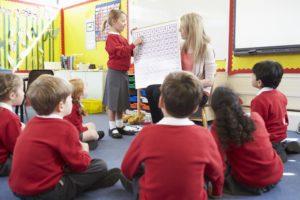 Teacher Teaching Maths To Elementary School Pupils